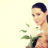 Spa woman with lily flower — Stock Photo