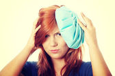 Woman with ice bag for headaches — Stock Photo