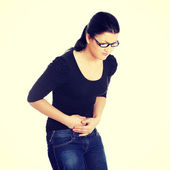 Young woman with stomach issues — Stok fotoğraf