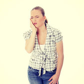 Beautiful young woman is having toothache — Stock Photo