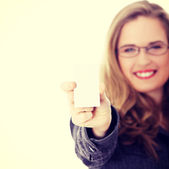 Businesswoman holding blank empty businesscard — Stock Photo