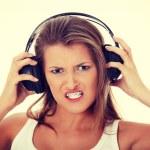 Teen girl listening aggressive music — Stock Photo #48912445