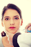 Plastic surgeons giving botox injection — Stock Photo