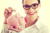 Business woman with piggy-bank — Stock Photo