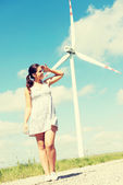 Girl next to wind turbine. — Stock Photo