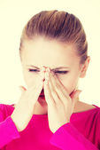 Woman is having sinus pressure. — Stock Photo