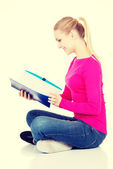 Young student woman with workbook. — Stockfoto