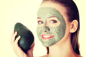 Woman in facial mask — Stockfoto