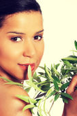 Woman with olive leafs. — Stock Photo
