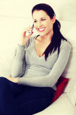 Woman is talking to the phone — Stock Photo