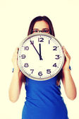 Woman holding clock. — Stock Photo