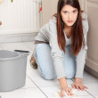 Young woman cleaning flor — Stock Photo #4965962
