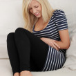 Blond woman with stomache issues — Stock Photo #4997901