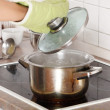 Young woman boiling something in pot — Stock Photo #5064913