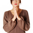 Young girl standing and praying. — Stock Photo #7646912