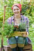Young woman gardening in a garden — Stock Photo