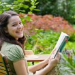 Junge Frau liest, Young woman is reading - Stock Photo