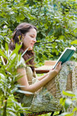 Young woman is reading — Stock Photo