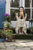 Young woman on a patio — Stock fotografie