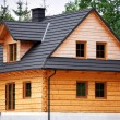 Wooden cottage — Stock Photo #25632489