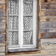 Rural much neglected window in wooden wall — Foto Stock #41379229