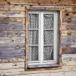 Rural much neglected window in wooden wall — Foto Stock #41386081