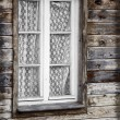 Rural much neglected window in wooden wall — Foto Stock #41877459