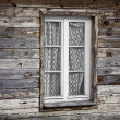 Rural much neglected window in wooden wall — Foto Stock #41877501