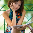 Pretty girl with a book in the park — Stock Photo