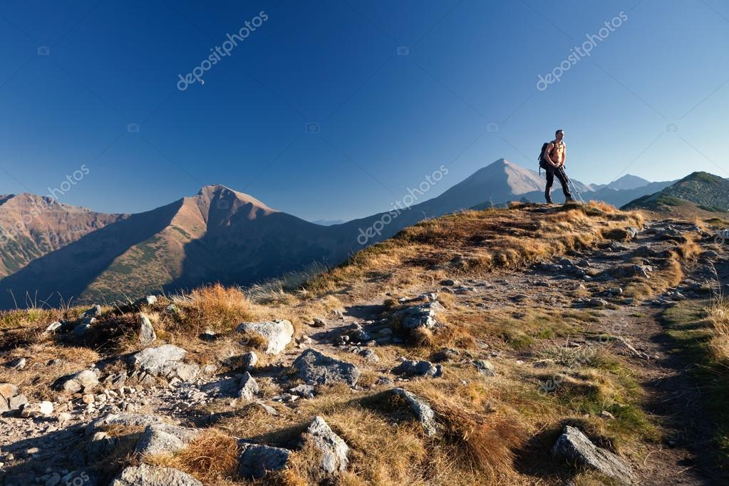Adult trekker is standing on top of the mountain Ornak in Tatra Mountains, Poland — Stock Photo #14068477