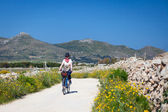 Woman is cycling at Favignana Island — Stock Photo