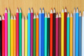 Colored pencils on a wooden table. — Stock Photo