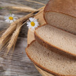 Bread on a wooden board. — Stock Photo