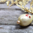 Christmas decorations: golden twig and balls - Стоковая фотография