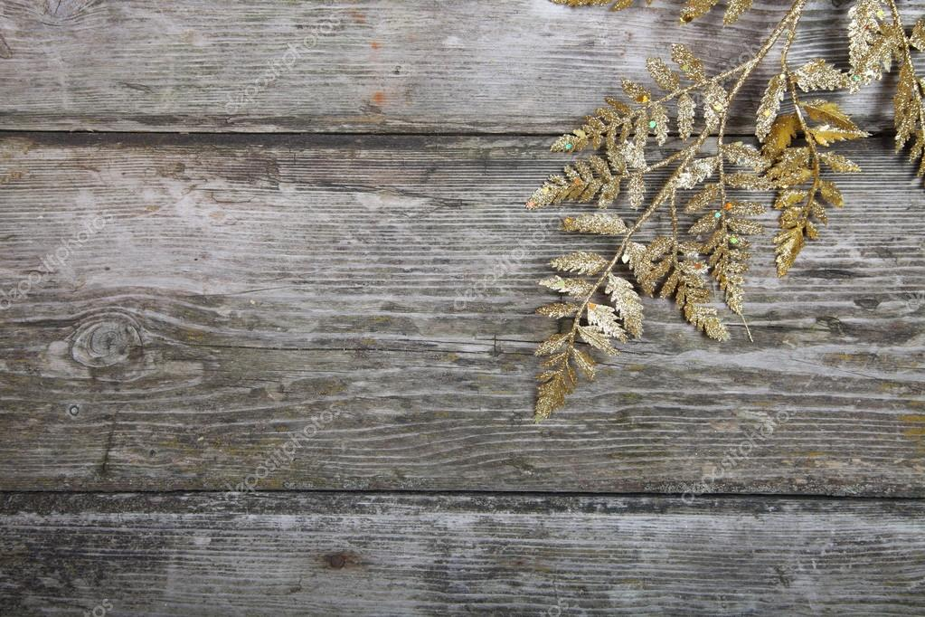 Christmas decorations: golden twig on a wooden background — Stock Photo #13639276