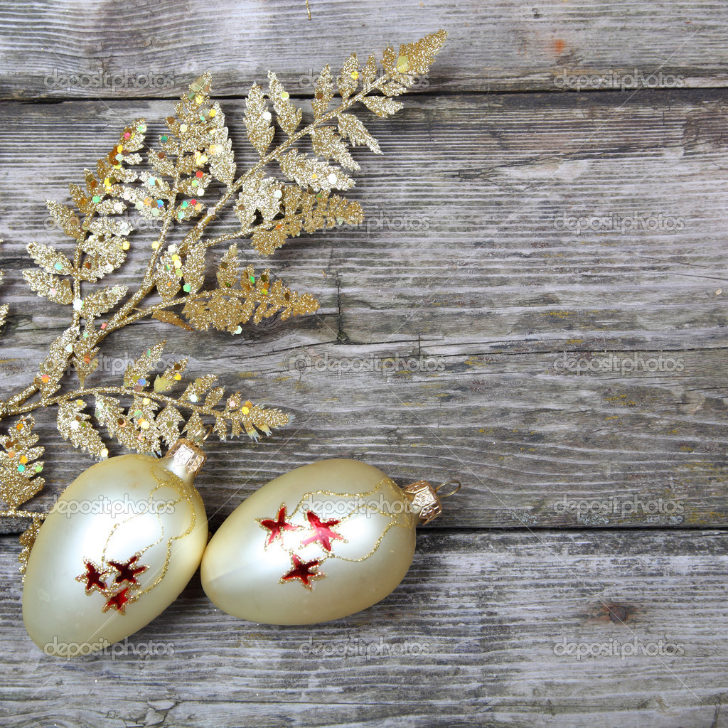 Christmas decorations: golden twig and balls on a wooden background — Stock Photo #13639277
