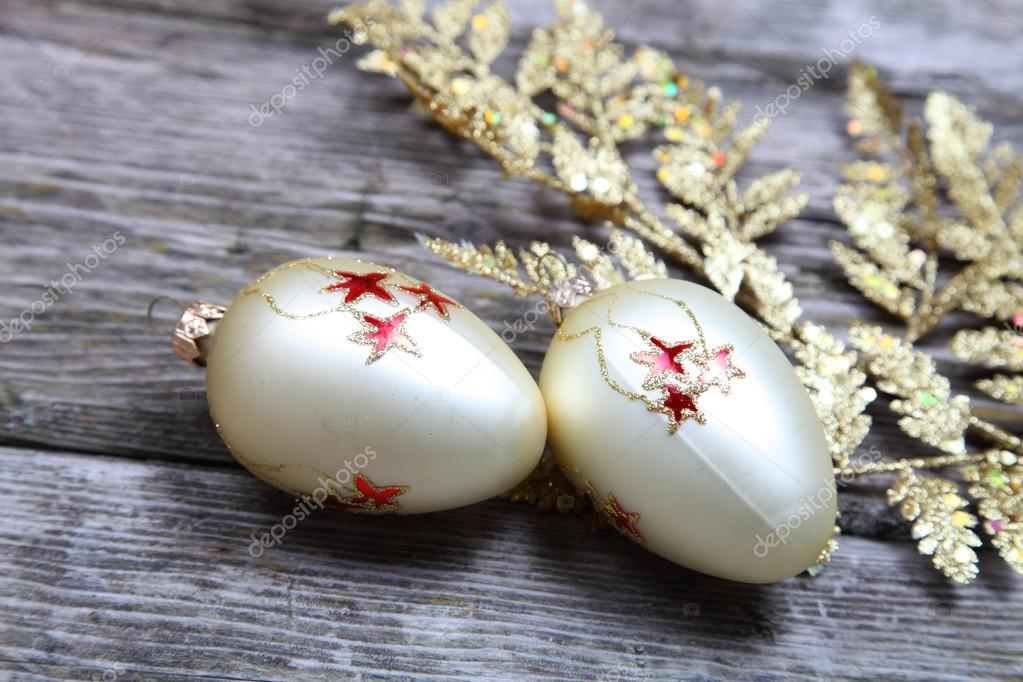 Christmas decorations: golden twig and balls on a wooden background — Stock Photo #13639279