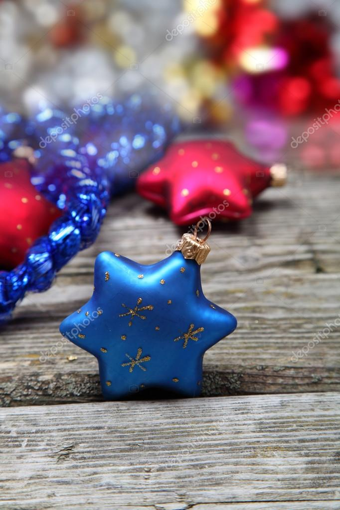 Christmas decorations. Stars and garland on a wooden background  Stock Photo #13639286
