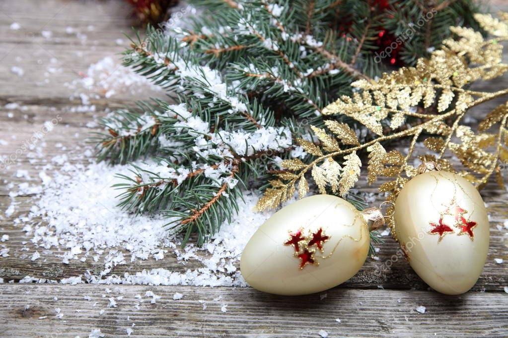 Christmas decorations on a wooden background  Stock Photo #13785436