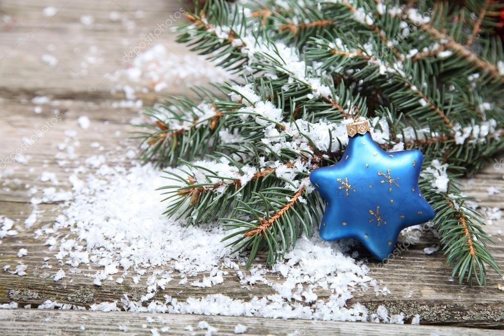 Blue Christmas decorations on a wooden background — Stock Photo #13785441