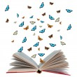 Open book with butterflies flying from it — 图库照片