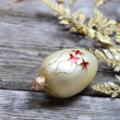 Golden twig and ball - Foto Stock