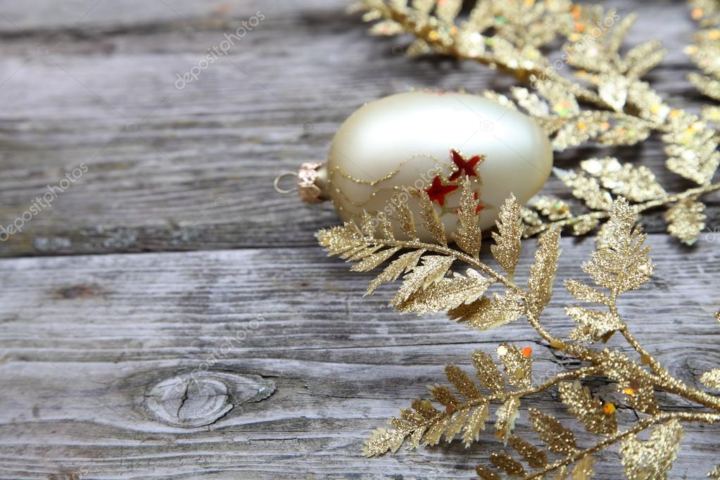 Golden twig and ball on a wooden background  Stock Photo #13954398