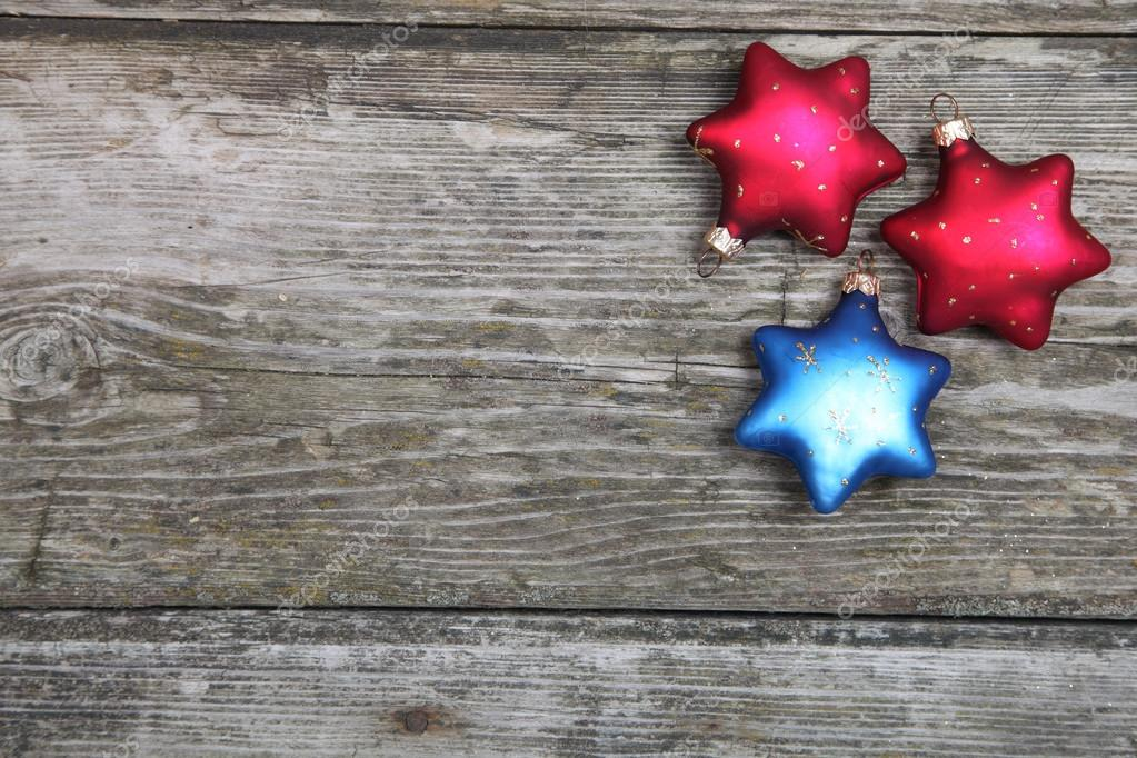 Christmas decorations. Stars on a wooden background — Stock Photo #13954401