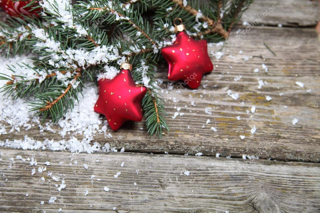 Red Christmas decorations on spruce branches with snow — Stock Photo #13954409