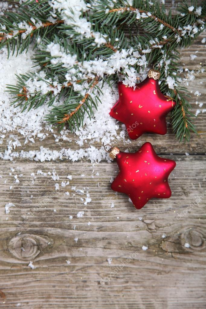 Red Christmas decorations on spruce branches with snow — Stock Photo #13954411