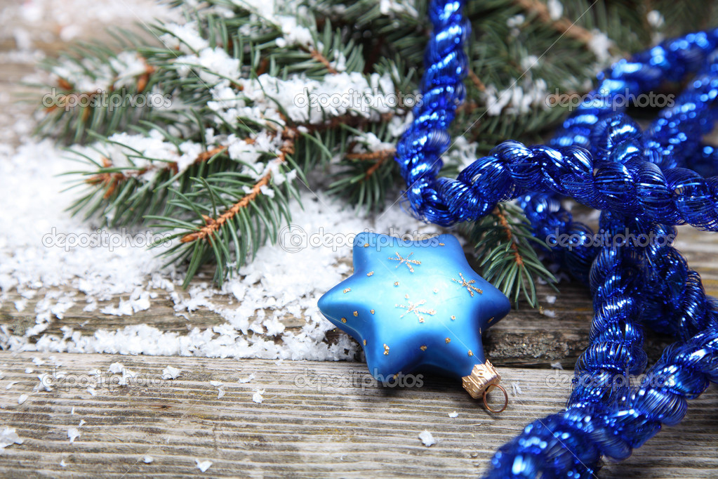 Blue Christmas decorations on a wooden background — Stock Photo #13954419