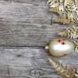Golden twig and ball — Stock Photo