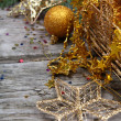 Golden Christmas decorations — Stock Photo #14101450