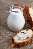 Glass jug with milk — Stock Photo